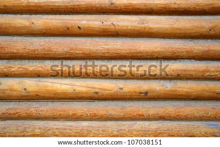 Wall of a log house - stock photo