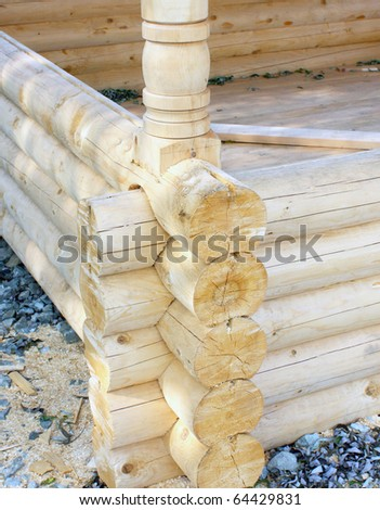 Wall of a rural log house from the fresh cut logs - stock photo