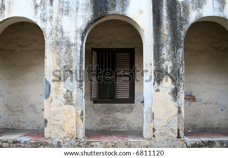 Wall of an old dilapidated building in an old block of Georgetown, Malaysia - stock photo