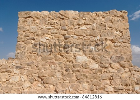 Wall of ancient fortress tower - stock photo