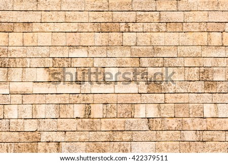 Wall of beige brick, texture. Toned - stock photo