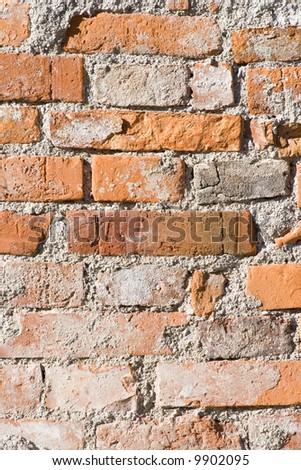 Wall of bricks on an old house facade