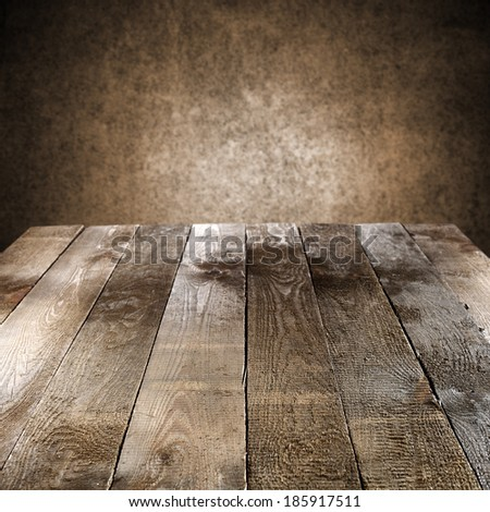 wall of brown and space on worn table  - stock photo