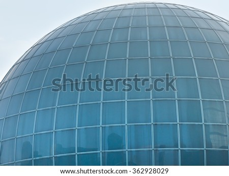 Wall of building in ball form with great number of windows. Architecture background.