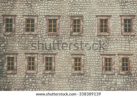 Wall of building with windows - stock photo