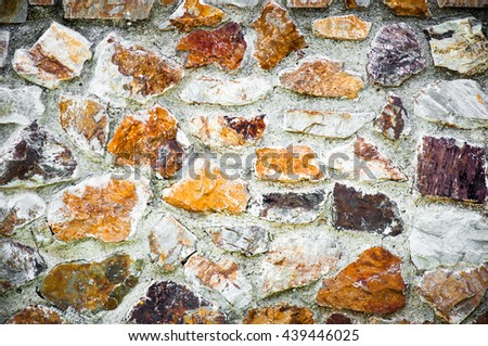 wall of colorful stone or rock - stock photo