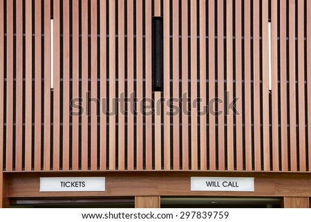 Wall of concert hall with tickets and will call signs - stock photo