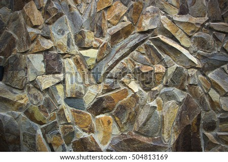 wall of granite boulders of different colors close-up