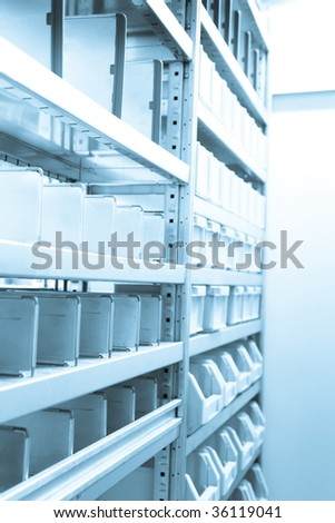 Wall of Gray Metal Filing Cabinets Drawers