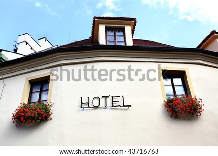 Wall of hotel close-up with windows and singboard - stock photo