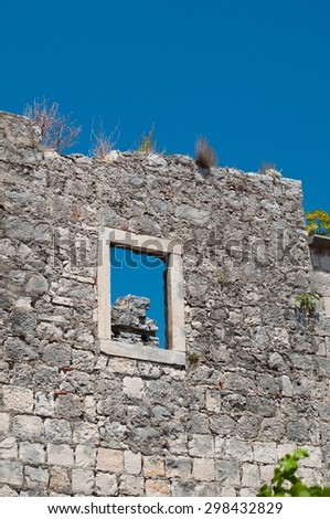 Wall of old building. Fragment of architecture in Korcula, Croatia. Vertical photo - stock photo