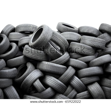 Wall of old car tires on white background - stock photo