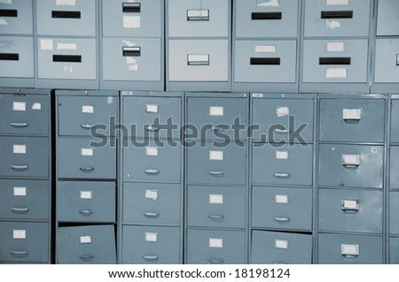 Wall of old gray metal filing cabinets drawers - stock photo