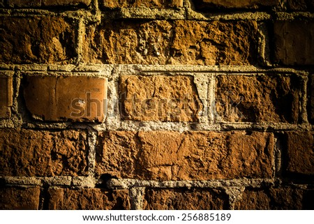 Wall of red bricks. Background. Toned. - stock photo