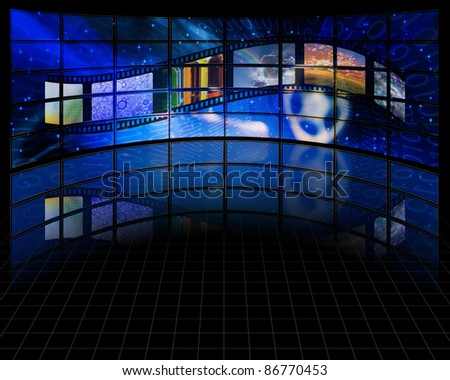 Wall of screens with film - stock photo