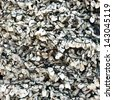 Wall of seashells mixed with cement close up. - stock photo