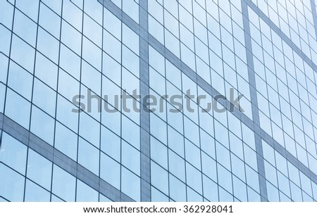 Wall of skyscraper with great number of windows. Architecture background.
