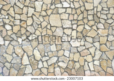 Wall of small stone fragments as a texture