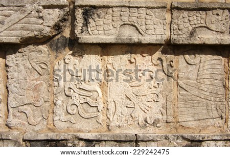Wall of temple with bas-relief at Chichen Itza, Mexico - stock photo