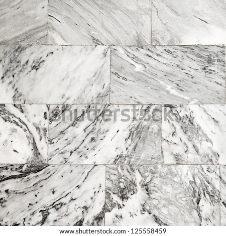 wall of the building of pale marble, grunge background - stock photo