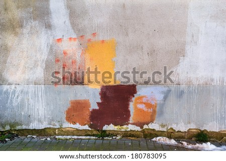 Wall of the building with lots of colorful spots - stock photo