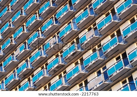 Wall of the high house with set of balconies - stock photo
