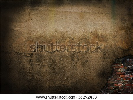 Wall of the old house with the fallen off plaster under which the red bricklaying is visible - stock photo