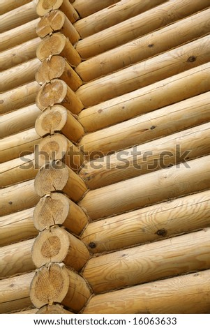 Wall of the rural house from logs - stock photo