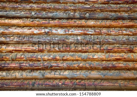 Wall of the rural house made from wooden logs. Seamless texture  - stock photo