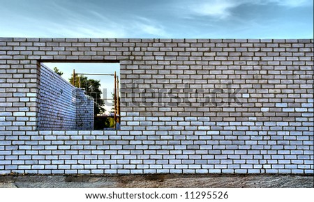 Wall of unfinished house with hole for window. Shot in Ukraine. - stock photo