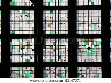 Wall of windows in an abandoned midwestern industrial facility. - stock photo