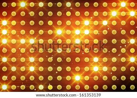 wall of yellow lighting bulbs  - stock photo
