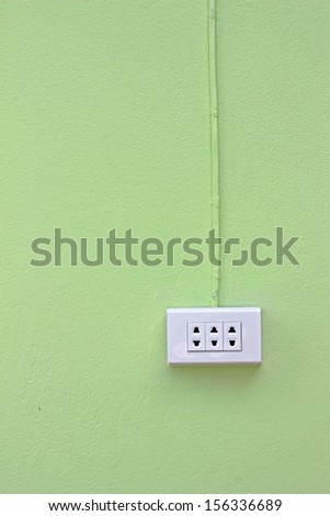 Wall outlets on green background - stock photo