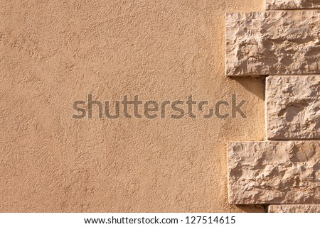 Wall partially lined with natural stone - stock photo