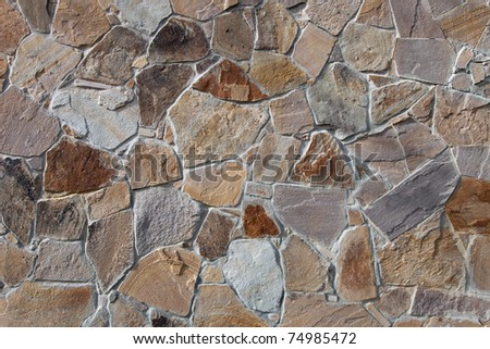 Wall paved with natural stone. Can be used as background - stock photo