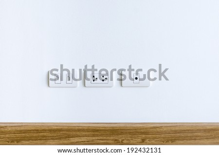 Wall Plug for electric, telephone and cable television - stock photo