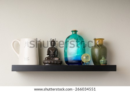 Wall shelf featuring various items - stock photo