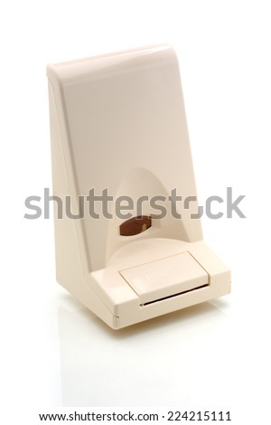 Wall soap dispenser isolated on white background - stock photo