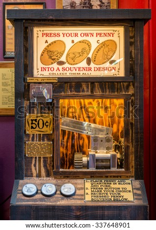 WALL, SOUTH DAKOTA - OCTOBER 28: Penny pressing souviner machine inside Wall Drug Store on Main Street on October 28, 2015 in Wall, South Dakota