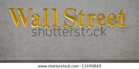 Wall Street in gold letters - stock photo
