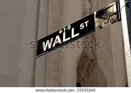 Wall Street road sign in the corner of New York Stock Exchange, an icon of global investment, finance, trading - stock photo