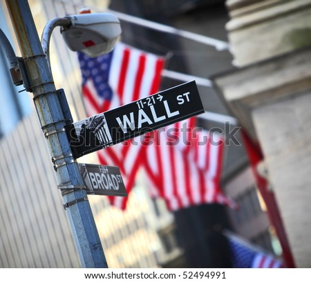 Wall Street sign and flag background in New York City - stock photo