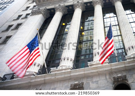 Wall street sign in New York, January 20, 2014 - New York Stock Exchange background - stock photo