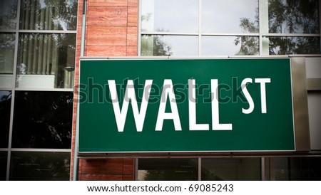 Wall Street sign on office building, business concept