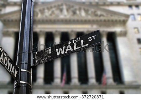 Wall Street sign with architectural building on the background. - stock photo