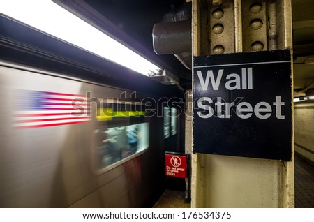 Wall street subway sign in New York City Manhattan station. - stock photo