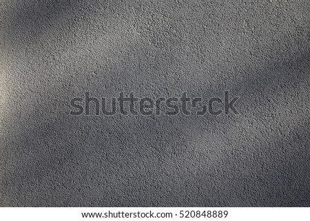 Wall surface with shadows. Background of a concrete wall.