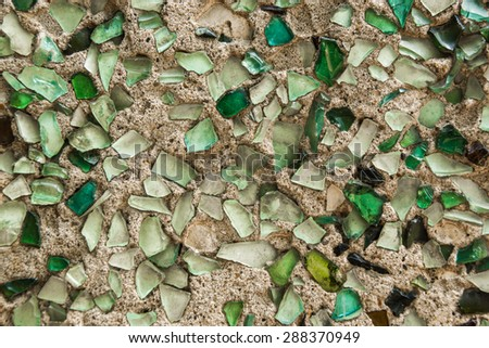 Wall texture with mosaic of a bright green bottle glass - stock photo