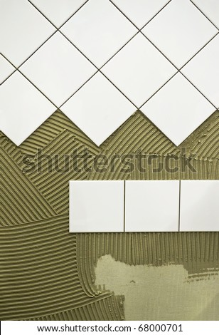 Wall tile glue - stock photo