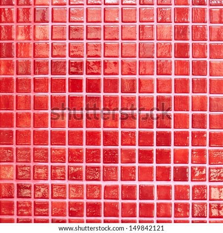 Wall tiled with red glazed tiles fragment as an abstract background - stock photo